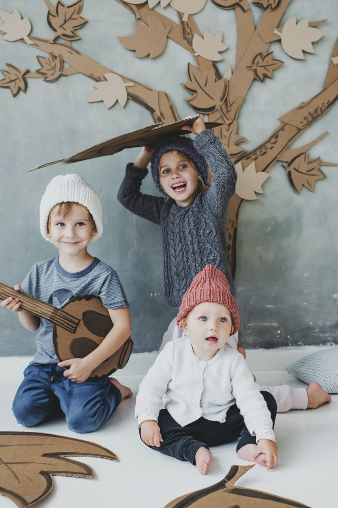 children-sitting-on-floor-playing-with-cardboards-3965542